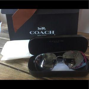 Authentic coach aviator sunglasses never worn.